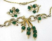 #Vintage 1960s gold tone floral set. Emerald green rhinestones necklace with…