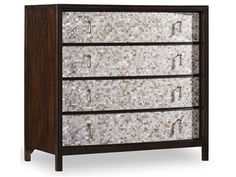 Our chests are a cornucopia of style and eclectic design. This chest features mother of pearl drawer fronts with figured walnut veneers.