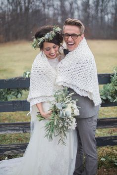 Winter wedding photo idea - bride + groom wrapped in white blanket {Conforti Photography LLC}
