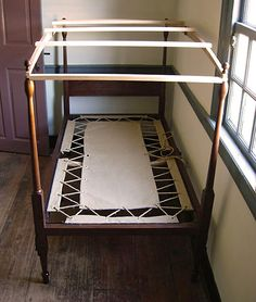 """George Washington's folding field bedstead in walnut wood, with hand sewn hemp canvas foundation, interpreted from multiple researched sources including observation of the original at Mt. Vernon. About The Living History Shop: """"We hand-build 18th century travel furnishings and field equipage to your specifications."""""""