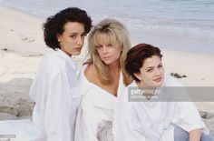 Publicity photo for the CBS television drama '2000 Malibu Road' shows American actresses (from left) Jennifer Beals, Lisa Hartman, and Drew Barrymore as they sit on the beach in white shirts, 1992.