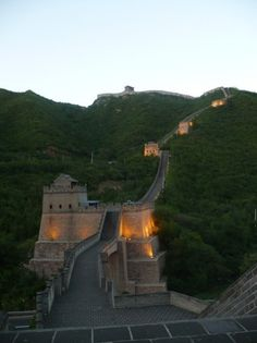 The lights go on at the Great Wall of China during sunset