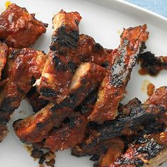 My son, EJ, loves these ribs, so I named them after him. I bake them with a spice rub, then baste them with sauce before they grill, and oh baby, are they moist and tender.