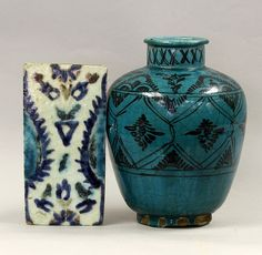 Persia, Late 19th- Early 20th Century., blue glaze vase with black design; 19th C. Persian blue and purple sun and floral tile. Length 6 in....