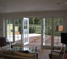 Bifold doors which can act like patio doors in case you only want to go into the garden or let in some air.  but not these faux-Georgian: