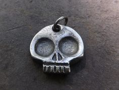One of a kind and unique hand forged skull keychain. It is forged to a heavy 1/4 thick. It can also be use to whatever you want, pendant, necklace