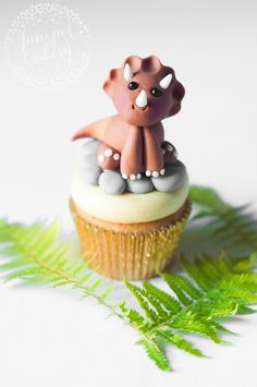 Learn to make this adorable dinosaur cake topper