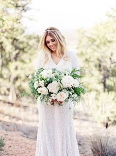 Overflowing white rustic wedding bouquet: Photography: Callie Manion Photography - www.calliemanionphotography.com   Read More on SMP: http://www.stylemepretty.com/2016/07/18//