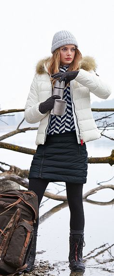 We all know those days when pulling an appealing winter look seems to be close to a Herculean task, so here's the solution: lightweight white down jacket with a horizontal quilting, clean lines, an adorable nuance as well as a Fire + Ice fur trim that may be ordered separately and applied to the hood, if you wish.