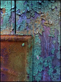Old and chipping paint, but beautiful in color and texture... I love the turquoise, purple, and the golden brown