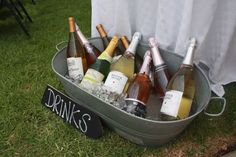 Metal bucket holds wine & champagne.