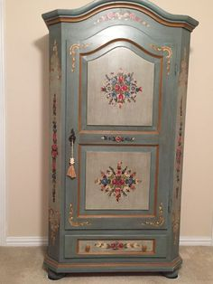 German Armoire, handpainted; purchased from a vacation hotel. It was in the basement laundryroom. 600 DM, or about $300 US