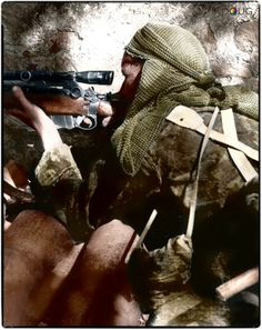 Private L.V. Hughes, 48th Highlanders of Canada, Cdn.1st Division sniping a German position near the Foglia River, on the Gothic Line in Italy.