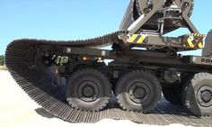 Faun Trackway is a truck that carries its own road surface, rolls it out like a rug, and then collects it after all the vehicles have crossed. Cool New Tech, Digital Fabrication, Cool Inventions, Guy Stuff, Cool Stuff, Military Vehicles, Transportation, Monster Trucks, Gi Joe