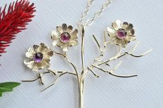 Handmade sterling silver statement zinnia necklace by Macalania