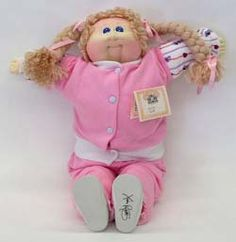 Looks ALOT like the soft face Cabbage Patch Doll I had....her name was Althea Carin  <3  DA