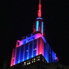 April 24, 2015: To celebrate the New York Rangers' playoff series win over the Penguins, the Empire State Building's tower sparkles in red, white and blue lights for 30 minutes.