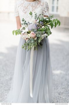 Two piece wedding dress with lace detailed top and pastel blue long skirt   Photographers: Inge Kooiman Fotografie   Planning & concept: Elsa Schaddelee   Wedding dress: Wild at Heart Bridal   Flowers: Mullers Floral Art   Hair & Make Up: The Beautiful Bride Company   Headpiece: Naturae Design #weddingdress
