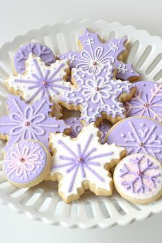 We have a tradition every first real snow of the year - We make snow cookies.  For us, they are ggrandma's shortbread dough decorated to look like snowflakes.  (this photo is future decorating inspiration) My girls always started to yammer to make cookies as soon as those first flakes hit the air.