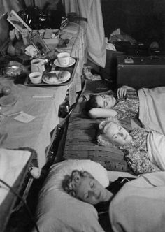 New rules for the dancers at the Windmill theatre, lights out at 11, the girls sleep on the floor of their dressing room as they eat, sleep and work at the theatre, 19th October 1940. Pictured are Margaret McGrath [lower],Sonia Stacpoole [Middle], and Wenda Hurst [top]. Original Publication : Picture Post - 316 - Backstage - pub. 1940. (Photo by Picture Post/Hulton Archive/Getty Images)