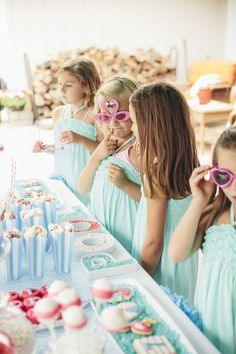 Little girls enjoying sweets at a Flamingo Pool Party via Kara's Party Ideas KarasPartyIdeas.com (12)