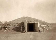 Here for your consideration is a pleasing picture of a Mandan Indian Earthen Lodge. It was created in North Dakota in 1908 by Edward S. Curtis.    The photograph presents an Earthen lodge, with bull boat by doorway.    We have created this collection of illustrations primarily to serve as a valuable educational tool. Contact curator@old-picture.com.