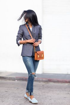 Wear a striped blazer with distressed jeans and loafers.