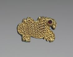 Griffin Fibula Frankish (Artist) PERIOD mid-late 6th century (Early Medieval) MEDIUM gold and bronze (Gold, Silver & Jewelry)