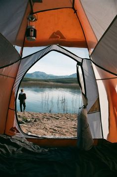 camping near mountains and a lake. perfect
