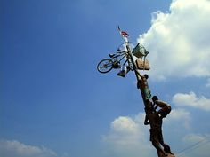 Independence Day race, climbing a greased bamboo oil 'panjat pinang'