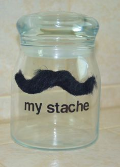 Kim's jar. Inexpensive Graduation Gift or College Gift. Re-purposed an old candle jar, bought the mustache at Party City for 25¢.