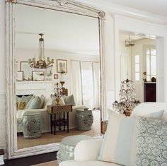 This mirror reaches from the window to the wall, and stretches out the dimensions of the living room.