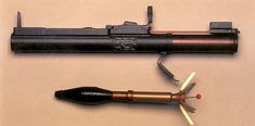 M72 LAW (Light Anti-armor Weapon) rocket launcher in extended (ready to fire) position and the M72 HEAT rocket / grenade in in-flight configuration, with tail fins extended.