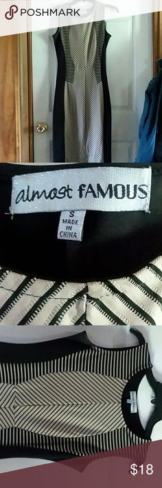 ALMOST FAMOUS body con dress ALMOST FAMOUS body con dress ,excellent condition, used once Almost Famous Dresses Midi