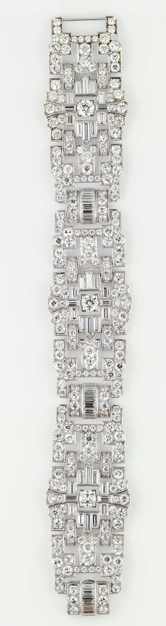 Impressive Art Deco 32 Carat Wide Diamond Platinum Bracelet. Impressive diamond and platinum wide bracelet, circa 1920s. It features exceptionally high quality round and baguette cut diamonds for its age, approx. 32cts total weight.