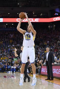 Klay Thompson of the Golden State Warriors shoots against the Philadelphia 76ers during an NBA basketball game at ORACLE Arena on November 11 2017 in...