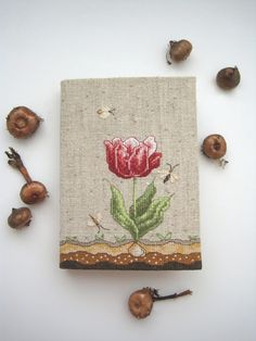Fabric book cover, love the way colours fabric been used to make  flower, leaves, soil, butterflies and the background to create a lovely  book cover.
