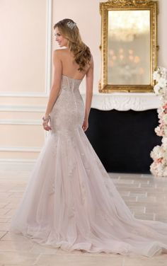 Check out the unique moscato color on this showstopping gown! Available at Spotlight Formal Wear! #SpotlightBridal