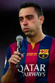 Xavi Hernandez of FC Barcelona cries as he speaks to the spectators after the La Liga match between FC Barcelona and RC Deportivo La Coruna at Camp Nou on May 23, 2015 in Barcelona, Catalonia.
