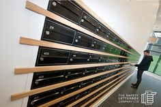 Wall Recessed Mailboxes with wood planks visually separating rows