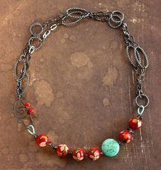 Love the colors and chain.  I think this is from one of the tv jewelry shows