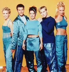 Snazzy style: The pop group, pictured in 1999, used to dress in some less smart attire
