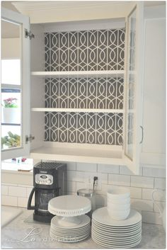 Love this idea of tacking fabric to the back of cabinets for easy change out...I'm doing it in the hutch in Roro's room...for starters.