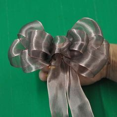 Great step-by-step directions with pictures to make this lovely bow ~ ribbon and floral wire