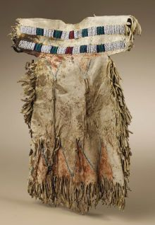 Native American:War Shirts/Garments, Sioux Doll Dress. Circa 1880. Length 11 1/4 in. Width 8 in.. Thisnative tanned deerskin doll dress is d...