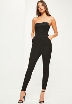 This black jumpsuit is perfect for staying hot when it's cool, with it's bandeau style top, satin panel and pocket details.