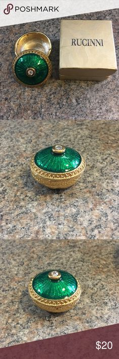 Rucinni Gift Box-Green Enamel & Crystal This is a beautiful, rare Rucinni Trinket Box.  Gold color with green enamel and a crystal accent on top.  This box features a twist top to close the box tight.  The dimensions Street 1 3/4 inches in diameter and 1 1/4 inches tall.  Thank you for viewing my item today!  Happy shopping! Rucinni Other