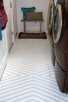 DIY from Retropolitan: Erika despised the tile floor in her laundry room, and decided painting them would be the most affordable option with the biggest impact. After some research and prep, she used painters tape to create a unique design.