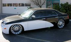 """chrysler 300, low rider, 22"""" wheels with roll royce paint style and grill. We call it """"Shamu"""""""