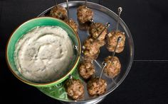 Spiced with cinnamon, cumin, and coriander, and served with a minty yogurt dipping sauce, these meatballs are an impressive appetizer.